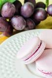 Macaroon. Grape macaroon on white dish Royalty Free Stock Photos