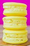 Macaroon. Lemon macaroon on pink&purple background Stock Photo