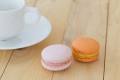 Macaroon , Macaron with cup on wooden background. Macaron , Macaroon with cup on wooden background stock photography