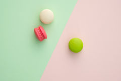 Macaroon many colors. Set of different colorful macaroons on many colors background. Sweet and tasty for cooking and restaurant menu. Top view royalty free stock photo