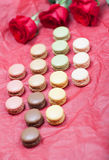 Macaroon on a paper background with roses Royalty Free Stock Photos