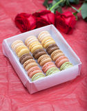 Macaroon on a paper background with roses Royalty Free Stock Image