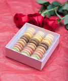 Macaroon on a paper background with roses Stock Photos