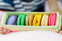 Macaroon in paper box Stock Photos