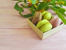 Macaroon pastry vintage biscuit color dessert , bakery alstroemeria flower on a wooden. Macaroon dessert  alstroemeria flower on a wooden pastry bakery biscuit Royalty Free Stock Image