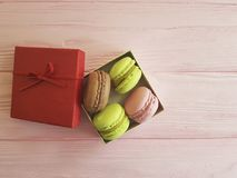 Macaroon on a pink wooden  confectionery  box romantic. Macaroon on a pink wooden dessert romantic confectionery Royalty Free Stock Images
