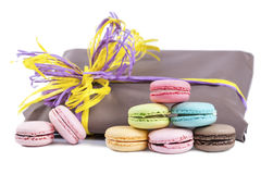 Macaroon pyramid on a background of gift packages isolated on wh Royalty Free Stock Photo