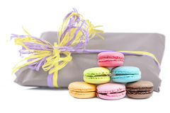 Macaroon pyramid on a background of gift packages isolated on wh Royalty Free Stock Photography