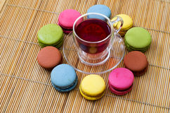Macaroon and red tea Stock Photos