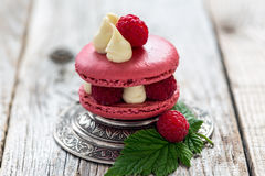 Macaroon with ripe raspberries. Royalty Free Stock Photography