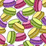 Macaroon seamless pattern. Sweet french macaron background in sketch style. Vector illustration.  Stock Photos