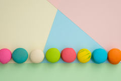 Macaroon. Set of different colorful macaroons on many colors background. Sweet and tasty for cooking and restaurant menu. Top view royalty free stock photography