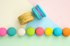 Macaroon. Set of different colorful macaroons on many colors background. Sweet and tasty for cooking and restaurant menu. Top view royalty free stock photos