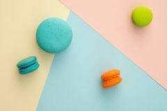 Macaroon. Set of different colorful macaroons on many colors background. Sweet and tasty for cooking and restaurant menu. Top view stock image