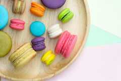 Macaroon. Set of different colorful macaroons Placed in a wooden tray, on many colors background. Sweet and tasty for cooking and restaurant menu. Top view royalty free stock photography