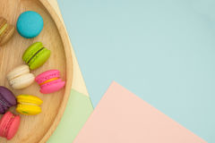 Macaroon. Set of different colorful macaroons Placed in a wooden tray, on many colors background. Sweet and tasty for cooking and restaurant menu. Top view stock image