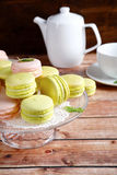 Macaroon on a stand with teapot and cup Stock Photography