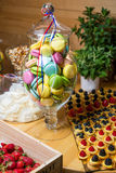 Macaroon, strawberries, cake with berries. Homemade sweets on a decorated table stock photo