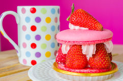 Macaroon. With strawberry in white dish Royalty Free Stock Photos