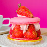Macaroon. With strawberry in white dish Stock Image