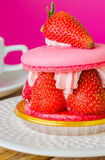 Macaroon. With strawberry in white dish Royalty Free Stock Photo