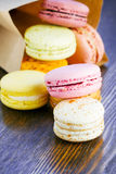 Macaroon strewn out of a paper bag Stock Images