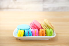 Macaroon. Sweet and colorful macaroon cookies in ceramic cup on wooden background with blank space,selective focus, Dessert Royalty Free Stock Photo