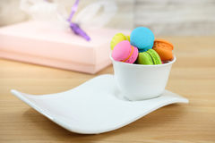 Macaroon. Sweet and colorful macaroon cookies in ceramic cup on wooden background with blank space,selective focus, Dessert Stock Photos