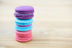 Macaroon. Sweet and colorful macaroon cookies tower on wooden background with blank space,selective focus, Dessert Stock Photos