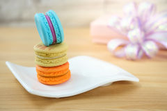 Macaroon. Sweet and colorful macaroon cookies tower on wooden background with blank space,selective focus, Dessert Royalty Free Stock Image