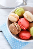 Macaroon in a white bowl Stock Image