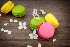 Macaroon on wooden & flowers Royalty Free Stock Photos