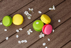 Macaroon on wooden & flowers Stock Photo