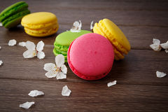 Macaroon on wooden & flowers Stock Photography