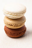 Macaroons. Three colors of macaroons in brown and beige tones Stock Photos