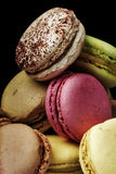 Macaroons. Typical french macaroons biscuits on black background Royalty Free Stock Photography