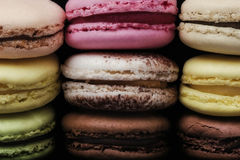 Macaroons. Typical french macaroons biscuits on black background Stock Image