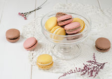 Macaroons. French macaroons in a bowl on the white table Royalty Free Stock Photography