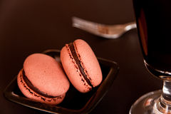 Macaroons as desert. A plate with  macarons, coffee and fork Stock Photography