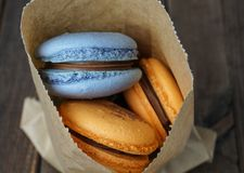 Macaroons in a backery paper bag Royalty Free Stock Photo