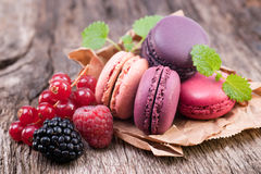 Macaroons with berries Stock Photography