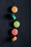 Macaroons biscuits in a row Stock Photo
