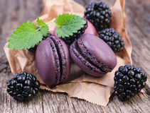 Macaroons with blackberries Stock Image