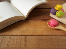 Macaroons on book royalty free stock photo