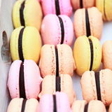 Macaroons in a box with heart Royalty Free Stock Photo