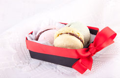 Macaroons in the box with red bow Royalty Free Stock Image
