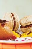 Macaroons and caramel pudding closeup Royalty Free Stock Photos