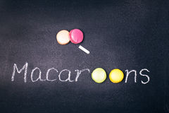 Macaroons on chalkboard Royalty Free Stock Photography