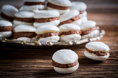 Macaroons with chocolate and nuts Royalty Free Stock Images
