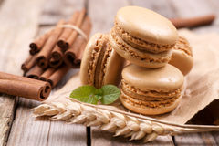 Macaroons with cinnamon sticks Stock Photo